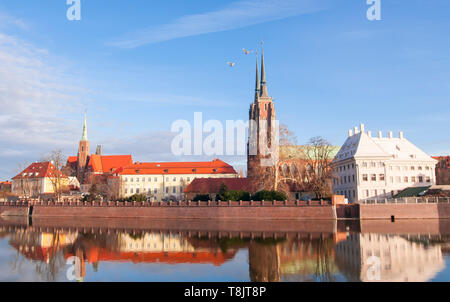 Cathedral of St. John the Baptist twin towers Odra river sunset Wroclaw, Poland, Europe - Stock Image