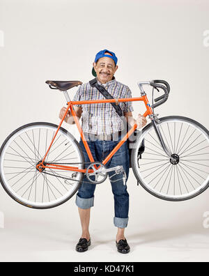 Senior Af-am man with bicycle studio portrait - Stock Image