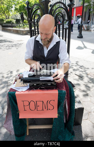 POET FOR HIRE who writes personalized  poems on his typewriter for a fee. In Union Square Park in manhattan, New York City. - Stock Image