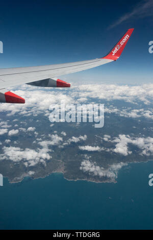 View from a cabin window of a Boeing 737 above the clouds - Stock Image