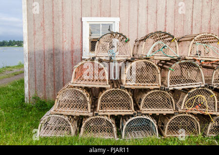 Lobster traps outside a fishing shed at French River, Prince Edward Island - Stock Image