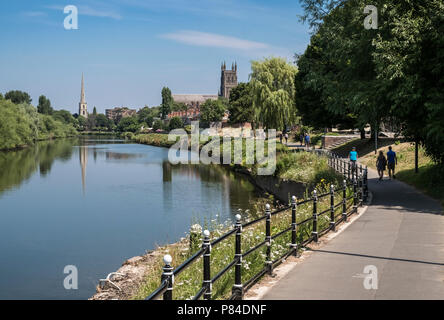 Riverside walkway along River Severn through city of Worcester, with Worcester Cathedral in the background, Worcestershire, West Midlands, UK - Stock Image