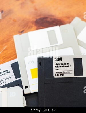 A pile of old Verbatum outdated technology floppy discs on a wood table. USA. - Stock Image