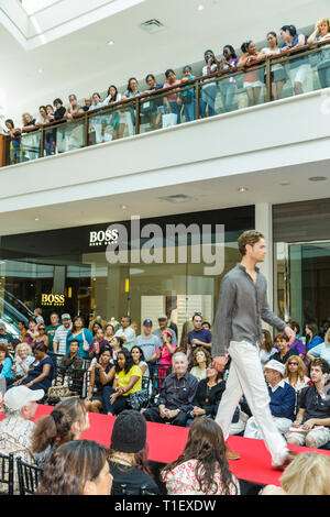 Florida Aventura Aventura Mall Fashion Show breast cancer research benefit charity event runway catwalk model modeling audience - Stock Image