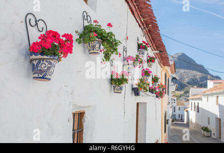 Alfarnatejo, white village up on the hill of Malaga mountains, Andalusia, Spain. Townhouses - Stock Image