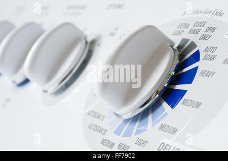 Photo of washing machine dials close-up. - Stock Image