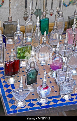 A display of traditioal Scent Bottles In the Souk the Street Market at Jemaa el Fnaa in the Medina Old City in the centre of Marrakech in Morocco. The - Stock Image