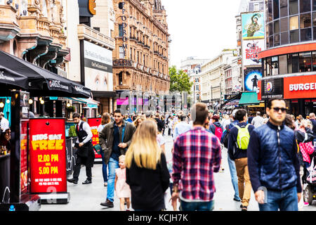 Leicester Square London UK England, Kids eat free sign, Leicester Square London busy with tourists, Leicester Square - Stock Image