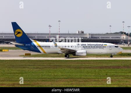 Ukraine International Airlines Boeing 737 Next Gen, at Milan - Malpensa (MXP / LIMC) Italy - Stock Image