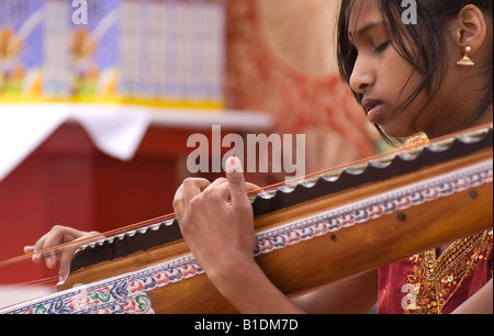 Patkunan playing a classical traditional musical instrument form the Tamil and South Indian tradition of carnatic - Stock Image