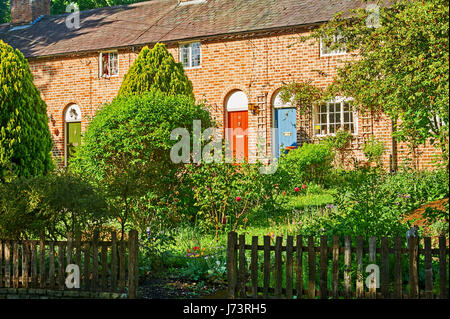 Brick cottages with coloured front doors in Stratford upon Avon, Warwickshire - Stock Image