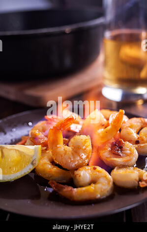 Fried shrimps in fire - Stock Image