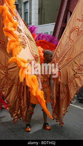 Caribbean Man Dressed as a Butterfly in the Notting Hill Carnival Parade 2009 - Stock Image