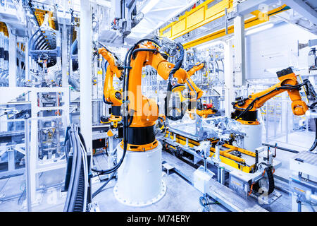 robotic arms in a car plant - Stock Image