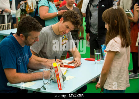 Greg James & Chris Smith book signing for fans in the bookshop at Hay Festival 2018 Hay-on-Wye Powys Wales UK - Stock Image