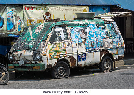 Old rusted van photographed in Bangkok's Chinatown (Thailand) - Stock Image