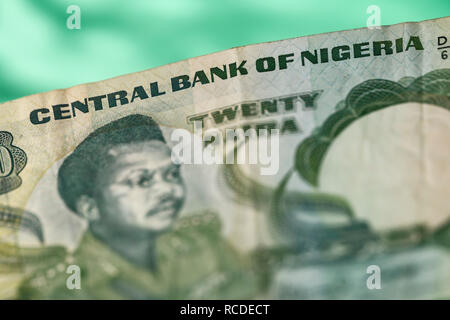 A close up detail of a twenty naira banknote issued by the Central Bank of Nigeria - Stock Image
