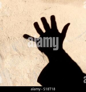 Counting with fingers - five - Stock Image