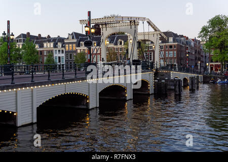 The Magere Brug (Skinny Bridge) over the river Amstel in Amsterdam, Netherlands - Stock Image