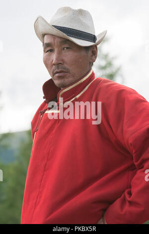 Mongolian wrestling competition near the Khovsgol Lake, Mongolia. The zasuul (coach) - Stock Image