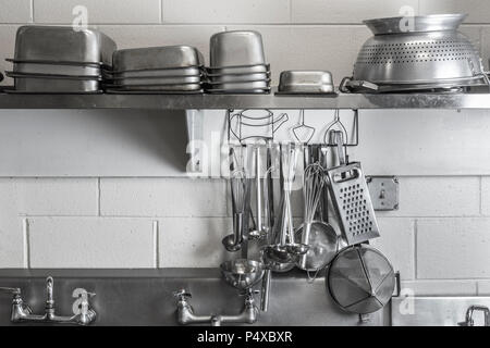 Restaurant Commercial Kitchen Stainless Steel Cooking Utensils - Stock Image