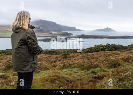 Woman alone walking in the countryside, Valentia Island, County Kerry, Ireland - Stock Image