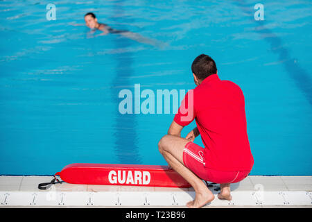 Lifeguard on duty by the pool. - Stock Image