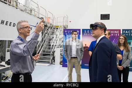 NASA Administrator Jim Bridenstine uses virtual reality glasses to tour the Gateway in the Space Station Processing Facility High Bay following an address to employees on the progress toward sending astronauts to the Moon and on to Mars at the Kennedy Space Center March 11, 2019 in Cape Canaveral, Florida. - Stock Image