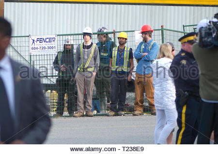 Construction workers waiting to see Canadian Prime Minister Justin Trudeau in Maple Ridge. - Stock Image