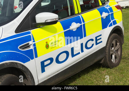 Police signage on the doors of a Lancashire Constabulary police car. - Stock Image