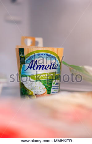 Polish Almette cream cheese with cucumber in a paper cup - Stock Image