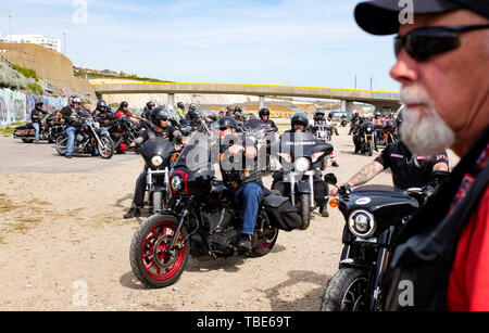 Brighton UK 1st June 2019 - Hundreds of Hells Angels gather on Brighton seafront by Black Rock car park as part of the clubs 50th anniversary celebration weekend . Over 3000 bikers from  around the world gathered in Surrey before heading down to Brighton today  . Credit : Simon Dack / Alamy Live News - Stock Image