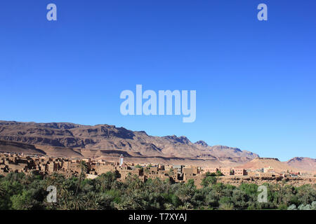 Tinghir Oasis with Atlas Mountains in Background, Morocco - Stock Image
