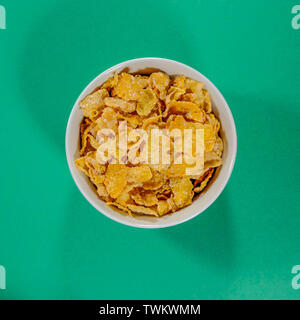 Bowl of Isolated Frosties Breakfast Cereals With No People - Stock Image