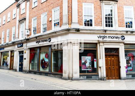 Virgin money bank shop store front virgin money sign above door entrance signs stores banks shops UK England - Stock Image