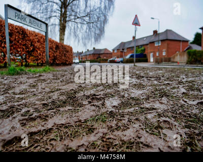 Ashbourne, UK. 14th Febraury, 2018. Mud everywhere at the end of the two day Ashbourne Royal Shrovetide hugball - Stock Image