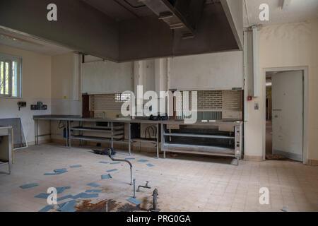 Large kitchen inside an abandoned prison. - Stock Image