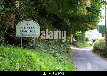 Sydenham Damerel sign on the road outside the village in rural Devon countryside in autumn England UK  KATHY DEWITT - Stock Image