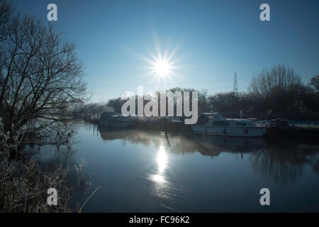 Early Morning Sun Over a River - Stock Image