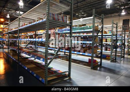 Rows of metal racks at a book warehouse - Stock Image