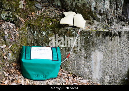 Roadside seismometer / seismograph, an instrument used for earthquake monitoring in a rural area of Japan. Japanese - Stock Image
