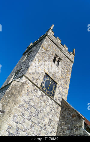 Church tower with clock against blue sky - Stock Image