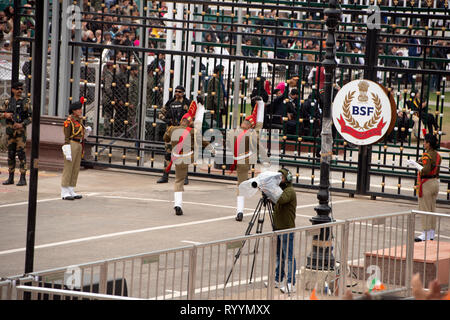Border Security Force and Pakistan Rangers soldiers show their rivalry at the lowering of the flags ceremony on February 15 2019. - Stock Image