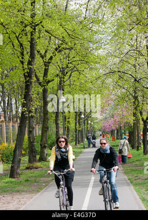People cycling in Berlin Germany - Stock Image