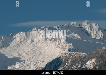 Snow covered peaks of the Coast Mountain Range near Vancouver, British Columbia in Canada - Stock Image
