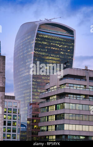 Walkie Talkie building towering over other buildings in City of London, England, UK - Stock Image