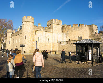 The famous London landmark  the Tower of London with blue skies with tourists people sightseers - Stock Image