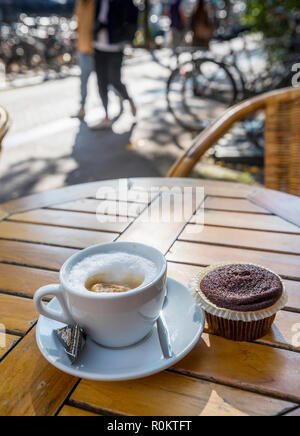 A cup of coffee with marijuana browne on the taible in Coffeshop in AMsterdam - Stock Image
