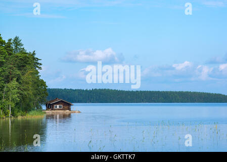 Small cabin in shore of lake in eastern Finland - Stock Image
