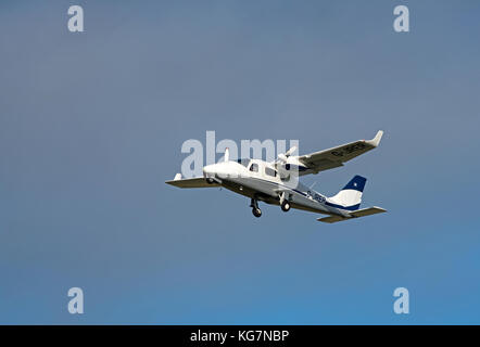 Tecnam twin engined 4 seat light aircraft departing from Inverness Airport  in the Scottish Highlands. UK. - Stock Image